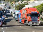 The V8 Supercars transporter parade makes its way through Ipswich.