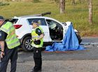 ONE woman has been killed and another seriously injured after a truck collided head-on with their car on the Bruce Hwy.