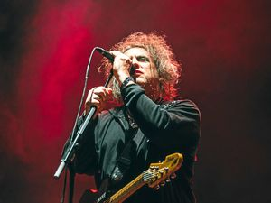 Robert Smith at the Splendour in the Grass Amphitheatre stage during The Cure's show.