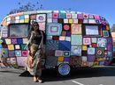 Lisa Burgess with her crocheted caravan.