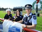 Sergeant Nadine Webster, volunteer Clair Turner and Inspector Keith McDonald promote the Crimestoppers Race Day to be held on August 19.