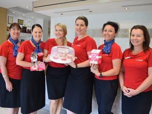 TASTY: Melissa Hutson, Carinda Ivens, Hannah Brown, Annette Harn, Melinda Butcher and Amanda Anderson from PRDnationwide are selling tasty cupcakes from today to raise money for the RSPCA. Photo Inge Hansen / Whitsunday Times.