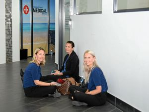 Medical and administration staff wait for answers after the doors to the Kingscliff Family Medical Services clinic were locked.