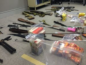 Police seize guns stockpile after raids near Toowoomba
