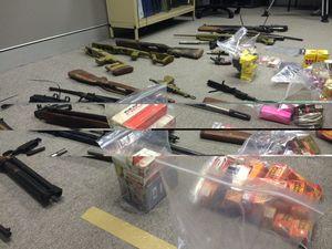 Police seize guns stockpile after raids near Toowoomba