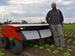 University of Sydney's Australian Centre for Field Robotics director of innovation and research Professor Salah Sukkarieh with RIPPA the robot at Rugby Farms, Gatton.