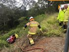 Woman pulled from overturned car down embankment
