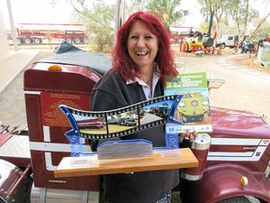 Trucking industry icon Liz Martin MOA with the award she received for her service to the National Road Transport Hall of Fame and her new book Australia's Road Transport Heritage last year.