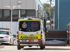 An ambulance attends the Toowoomba Police station after a medical emergency at the watch house, Saturday, July 30, 2016.