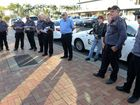 LEVEL PLAYING FIELD: Disgruntled taxi drivers gather outside Leanne Donaldsons office.