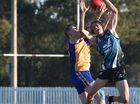 Some of the action from the AFL Wide Bay clash between Bay Power and Across The Waves at Keith Dunne Oval, Hervey Bay.