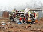 BLAST ZONE: A damaged fire truck at the scene of the horrific Charleville truck explosion.