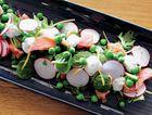 Confit salmon with green pea and radish salad.