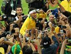 MAN IN THE MIDDLE: Neymar is swamped by media and fans after receiving his gold medal at the Maracana Stadium.