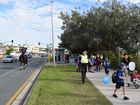 Police, parents and Mooloolaba State School students take part in the walk to school program.
