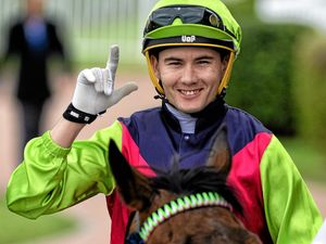 Michael Hellyer celebrates winning on Big Mama in the Brothers Leagues Club Maiden at Bundamba on Friday.