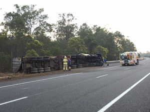 Truck overturns in Warrego Hwy collision with 4WD