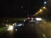 DashCam shows the moment a scooter gets sideswiped on a wet night.
