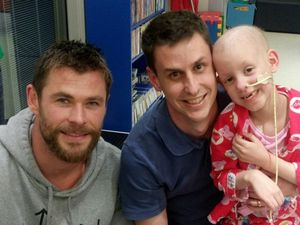 STAR VISIT: Hollywood heartthrob Chris Hemsworth visits Craig Box and his daughter Violet Box at Lady Cilento Children's Hospital in Brisbane. Craig's family originate from Maryborough.