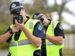 ROAD SAFETY: Constables Bradley Threkeld and Steve Freney take part in speed detection training in Bundy this week.