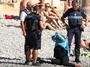 Burkini ban: French police force woman to strip on beach