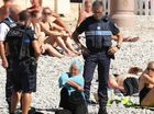ARMED police have forced a woman on a beach in Nice to remove her burkini as part of a controversial new ban.