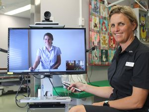 HEALTH INNOVATION: Clinical nurses Naomi Williams (on screen) and Jenine Horrocks encourage residents to consider using the available Telehealth service of having doctor appointments through a video. Photo Anastassia Perets / Central and North Burnett Times