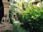 BALI SPLENDOUR: A moss-covered statue takes pride of place amongst the magnificent tropical gardens at Honeymoon Guesthouse.