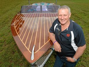 PRIDE AND JOY: Rob White with his treasured timber boat, something he had always wanted to own.