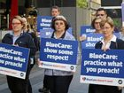 Leading a protest at Blue Care's Brisbane City office are (front, from left) Penny O'Brien, Pat McLean and Allana Johnson.