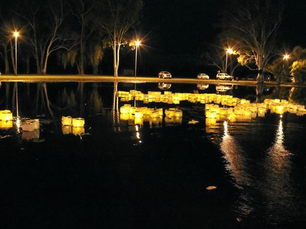 AFLOAT: Floating Lantern Ceremony at the Clermont Gold and Coal Festival paid tribute to the great flood in Clermont in 1916.