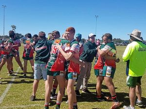 Chinchilla Bulldogs U16s celebrate after winning their grand final against the Wallumbilla / Surat Red Bulls in Roma today.