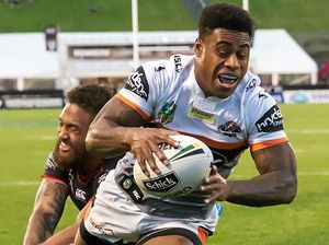 TRY: Kevin Naiqama of the Wests Tigers beats Manu Vatuvei of the Warriors to score.