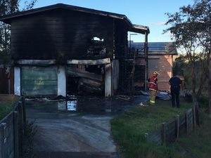 Man and dog escape house fire at Bellbird Park