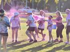 Colour Challenge at Seafront Oval - 8 yr old Dan Lindley from Maryborough throws another burst of pink at the participants.