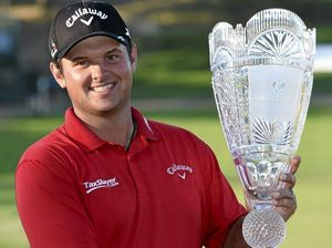 CUP LEADER: Patrick Reed smiles as he holds the The Barclays trophy.