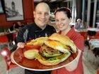Chef Michael Melcic and manager Tara Melcic with the Tower Central Cafe Noa burger that has been voted as Ipswich's best burger.