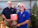 John Dowling and Ian Thomson from the Richmond Valley Woodcrafters Club display the raffle prize on offer at the Quota Alstonville Craft and Garden Fair: a lamp made by Mr Thomson from coloured pencils.