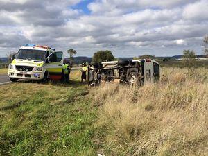 Paramedics treat driver after van rolls near Toowoomba