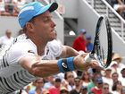 Australian out of the US Open after a gallant four-set second-round loss to French star Jo-Wilfried Tsonga.