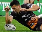 CRUCIAL MOMENT: Jordan Kahu of the Broncos puts the ball down to score what was deemed a penalty try by the video referee, despite the ball coming loose after being kicked out by Titan Konrad Hurrell.