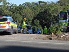 Emergency services tend to a man who was injured when he became pinned between a ute and a house wall at Diddillibah.