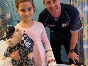 Champ visits hospital