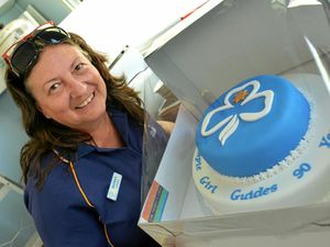 BIRTHDAY WISHES: Gympie Girl Guides leader Leonora Cox with the 90th birthday cake.