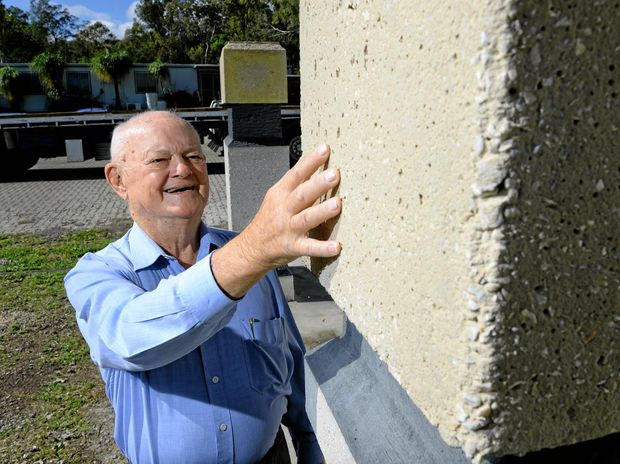 IMPRESSED: Ipswich/Rosewood Coalminers Memorial Trust chairman Beres Evans inspects the protoype columns that will adorn the memorial in Limestone Park.
