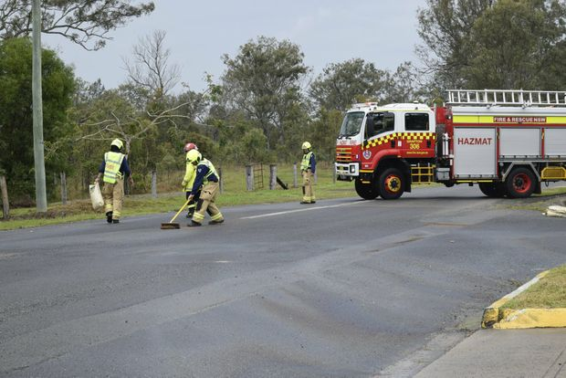 SPILL: Firefighters from Grafton Fire and Rescue NSW work to contain a diesel spill spreading across Duncan's Ln.