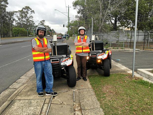 BROKEN PATHS: Field engineers Teyen Widdicombe and Luke Gibney will survey Logan's footpaths on quad bikes.