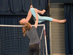 Amelia McKay, 8, trying out trapeze .