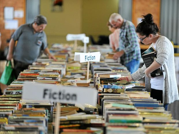 PAGE TURNERS: Stock up on some holiday reading material at the Kawana Library Spring Book Sale.