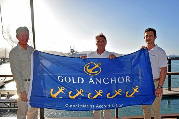 THAT'S GOLD: Marine Industries Association CEO Colin Bransgrove with Abell Point Marina owner Paul Darrouzet and manager Luke McCaul celebrate the marina's five gold anchor accreditation. Photo Rory Sheavils / The Guardian